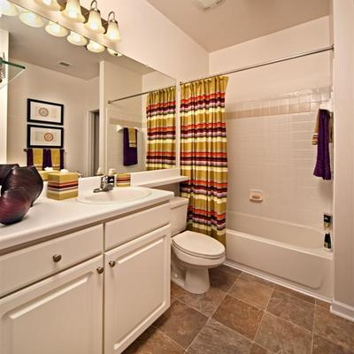 Large luxury baths with garden tubs, accent tile, linen closets & vanities