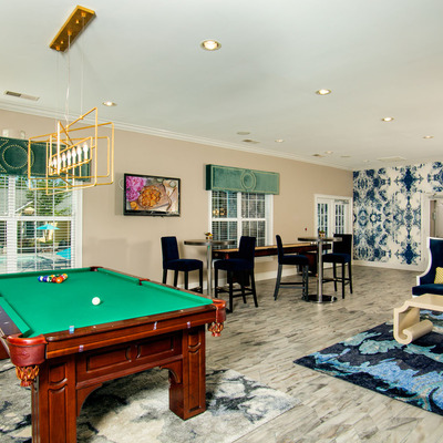 Clubroom with pool table, shuffleboard table and HD TVs